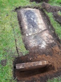 The gravestone after fully exposing the base and stone
