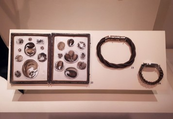 A collection of hairwork, including pieces for men on the right. National Museum of Scotland (photo by author 2019)